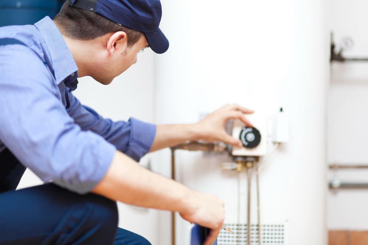 technician repairing an hot water heater